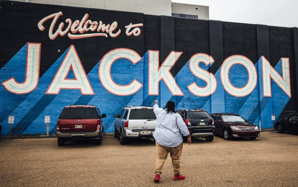Jeff Jenkins in front of the Welcome to Jackson Mural